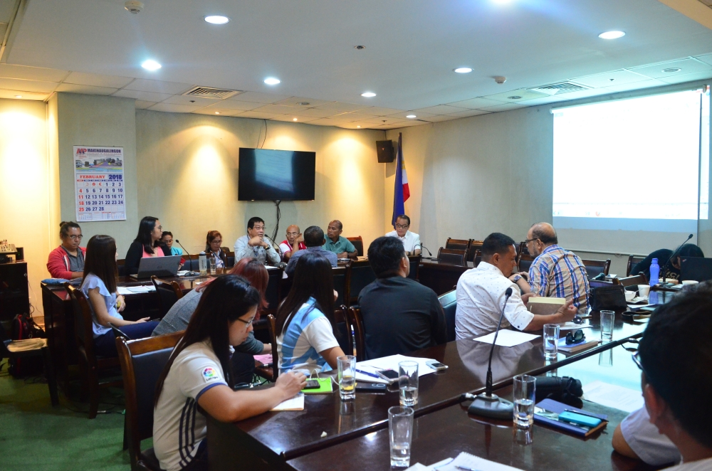 ILOILO. Communications Associate Candeze Mongaya of Oceana Philippines (woman in pink) shares her view during the convergence meeting on ecosystems approach to fisheries management of the Visayas Sea in the Governor's Boardroom here last February 19. (Contributed photo)