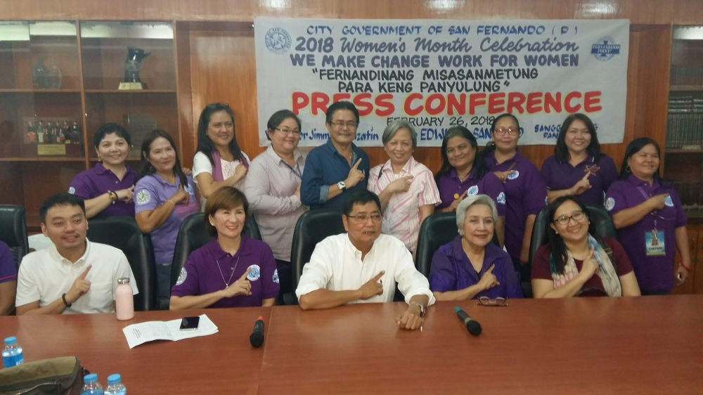 SAN FERNADO. Mayor Edwin Santiago, Councilor BJ Lagman and City Administrator Fer Limbitco join Fernandinas and women leaders Councilor Angie Hizon, Dr. Letty Yap, Ching Pangilinan, Engr. Emy Agoncillo and GAD focal person Amy Catacutan in flashing the Fernandina First sign during Monday's Women's Month press conference at city hall. (JTD)