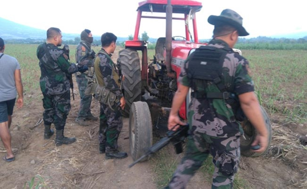 BACOLOD. Policemen arrive in Baranga Sag-ang, La Castellana, Negros Occidental, where a tractor was allegedly burned by suspected New People's Army rebels on February 25, 2018. (Photo courtesy of La Castellana Municipal Police Station)