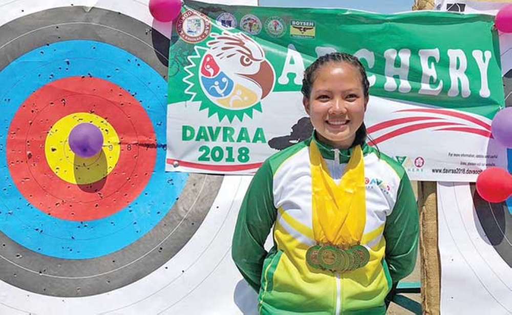 DAVAO. Davao City archer Davao Franceska Gacal is the most bemedaled athlete of the just-concluded Davao Region Athletic Association (Davraa) Meet 2018 after harvesting all eight golds at stake in the secondary girls division of the archery competition held at the Davao Archery Club in Lanang Business Park, Davao City. (Contributed photo)