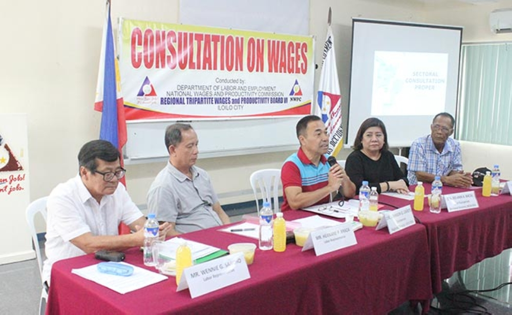 BACOLOD. RTWPB-Western Visayas Chairman Johnson Cañete (center) with other board members during the second wage consultation at Dole-Negros Occidental Office in Bacolod City Wednesday. (Contributed Photo)