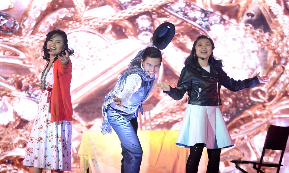 DAVAO. Yoshiko Hirakawa (Miss Hannigan), Gabriel Vince Zablan (Rooster Hannigan) and Khloe Orillan (Lily St. Regis) rock the stage as the conniving impostors.