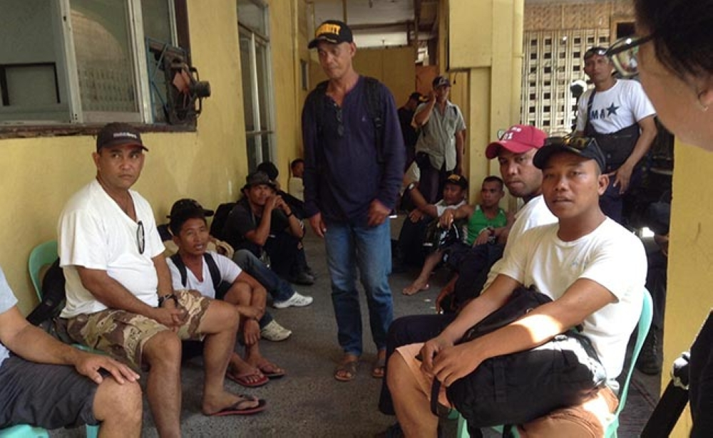 BACOLOD. Some of the security guards who were brought to the National Bureau of Investigation-Bacolod office following a raid at Maricalum Mining Corporation in Sipalay City Monday. (Teresa D. Ellera Photo)