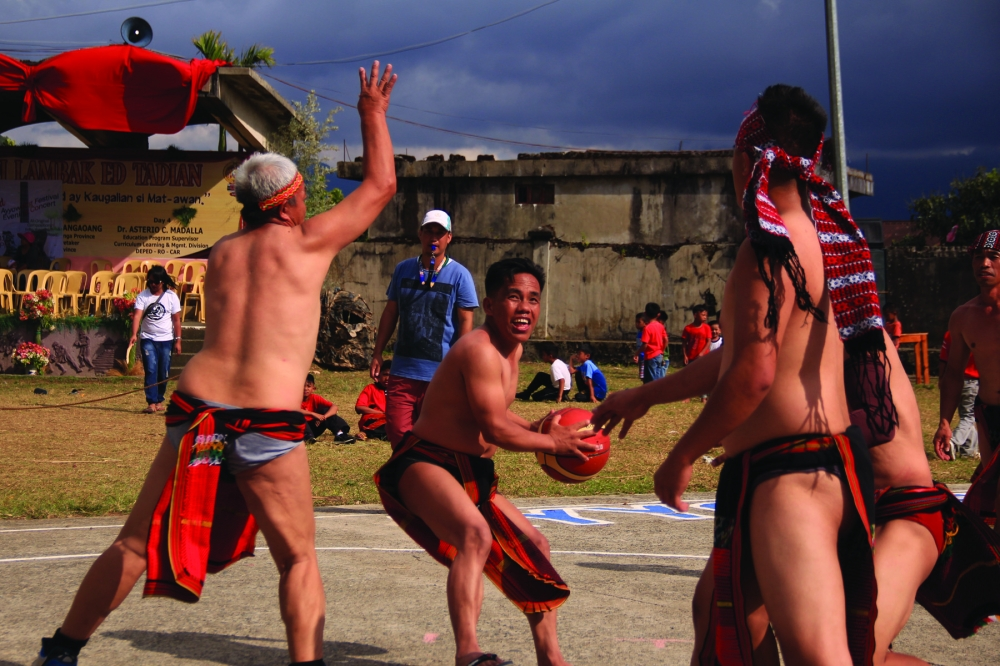 TADIAN. Tadian town in Mt.Province showcases their own version of basketball with men garbed in G-strings (traditional attire) as part of the Ayyoweng Festival 2018. (Lauren Alimondo)