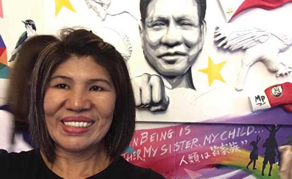 LEYTE. Warblitz Martinez, of Palompon, Leyte, receives her award as one of this year's 'Inspiring Filipina Entrepreneurs