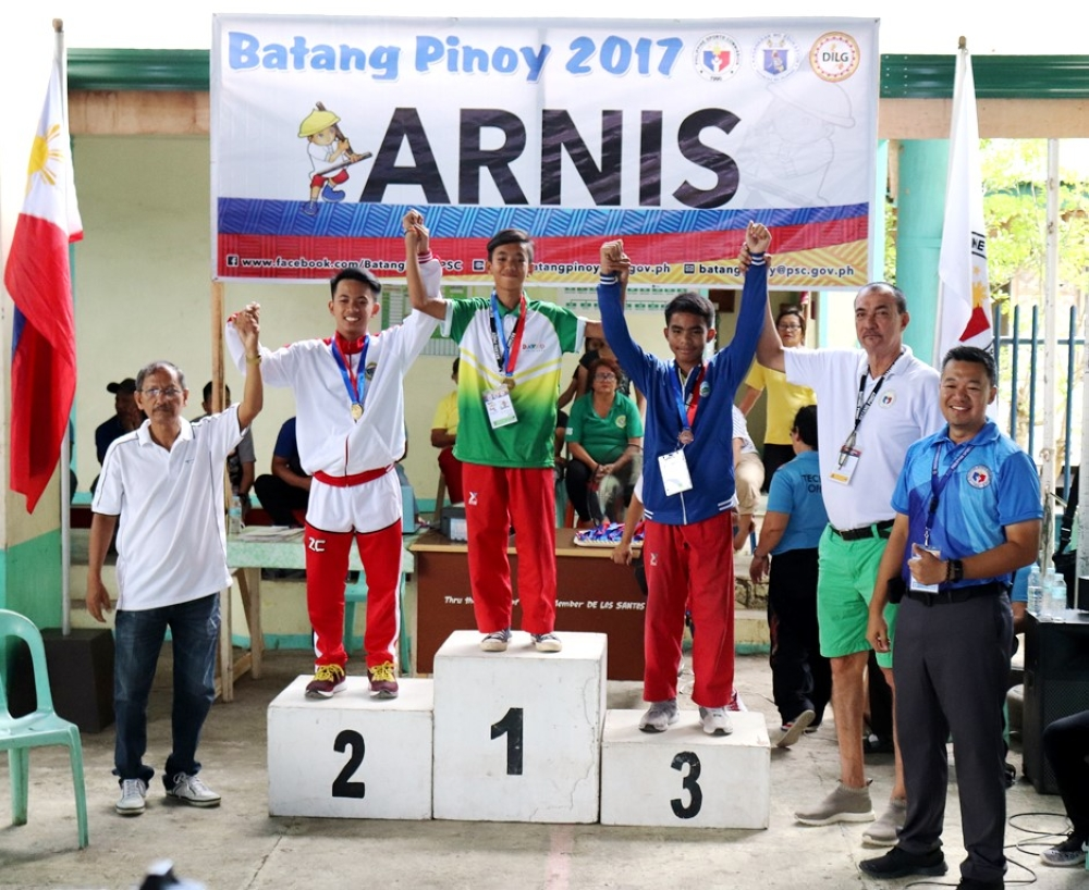MISAMIS OCCIDENTAL. A Davao City bet, third from left, raises the hands of his fellow medalists in the arnis competition of the Batang Pinoy Mindanao Leg in Oroquieta City. (Contributed Photo)