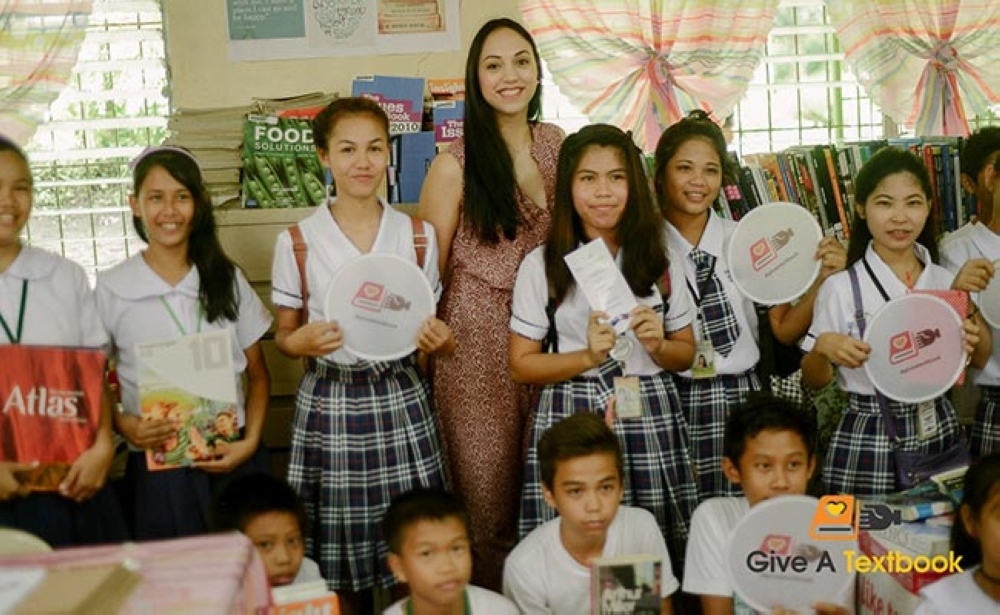 BACOLOD. Samantha Bonney, founder of Give A Textbook, with students at Labilabi National High School in Toboso. (Photo courtesy of Give A Textbook)
