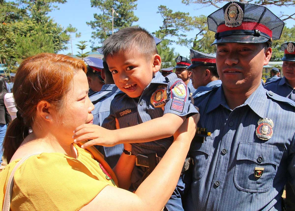 BAGUIO. Newly promoted SPO1 Bernardo Corona of the Baguio City Police Office is accompanied by son and wife during the donning an dinning of ranks ceremony held at Camp Bado Dangwa on March 12, 2018. (Milo Brioso)