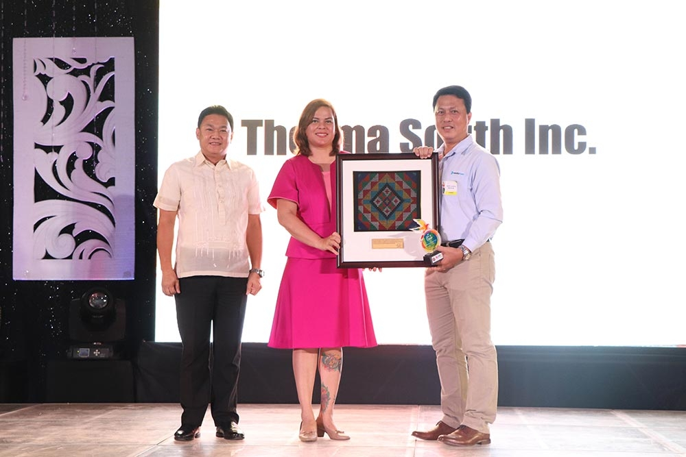 DAVAO. TSI Vice President and Plant Manager Valentin Saludes III (right) receives the top real property taxpayer award from Davao City Mayor Sara Duterte (center) and City Assessor Jaime Adalin (left). (Contributed photo)