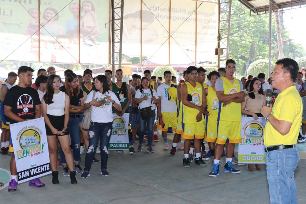 APALIT. Apalit Mayor Peter Nucom tells players coming from 12 barangays to observe sportsmanship, camaraderie and fair play during the opening of the 2nd Mayor Peter C. Nucom Inter-Barangay Basketball Tournament on Friday, March 16, held at the San Juan Covered court. (Chris Navarro)