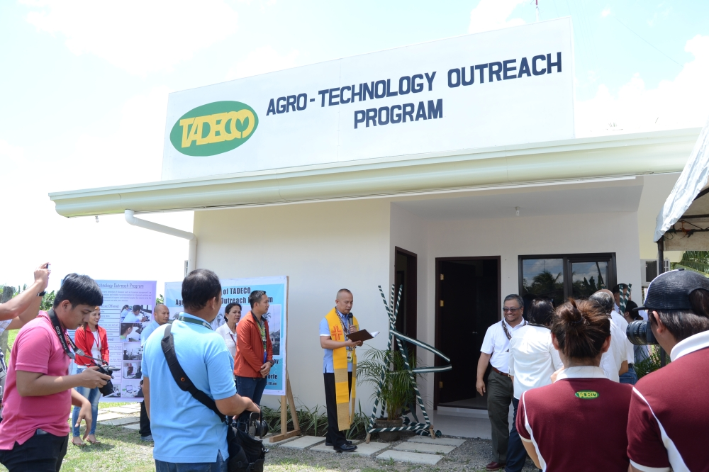 DAVAO. Anflo Group of Companies President and CEO Alexander Valoria (far left) leads the ribbon cutting of the receiving area of Tadeco's Agro-Technology Outreach Program last March 12 in Magsaysay, Carmen, Davao del Norte. In photo with him are (from second left to right) Mayor Leah Marie Moral-Romano of B.E Dujali, MBFEA Executive Director Evelyn Magno, Anflocor SVP Ricardo Floirendo, Mayor James Gamao of Panabo, PBGEA Executive Director Stephen Antig, Mayor Virginia Perandos of Carmen and Mayor Daniel Batosalem of Sto. Tomas. (Photo by Tadeco)