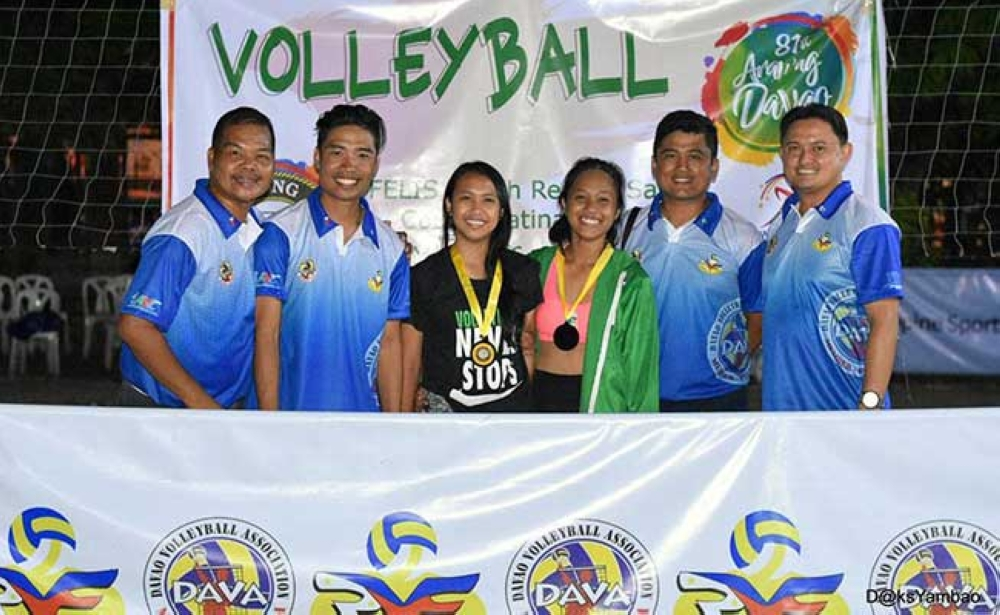 DAVAO. The Igacos volleybelles wear their genuine smiles and gold medals with the officials of the 81st Araw ng Dabaw Youth Beach Volleyball Tournament that came to a close on March 18 at the Felis Resort Complex. (D'Artagnan Yambao photo)