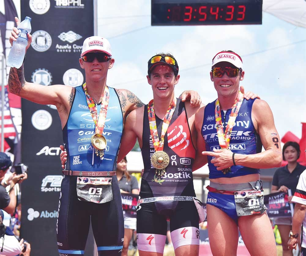 DAVAO. The 2018 Alveo Ironman 70.3 Davao Pro Men Champion Mexican Mauricio Mendez (center) with second and third placers Australians Timothy James Reed and Tim Van Berkel. (Mark Perandos)