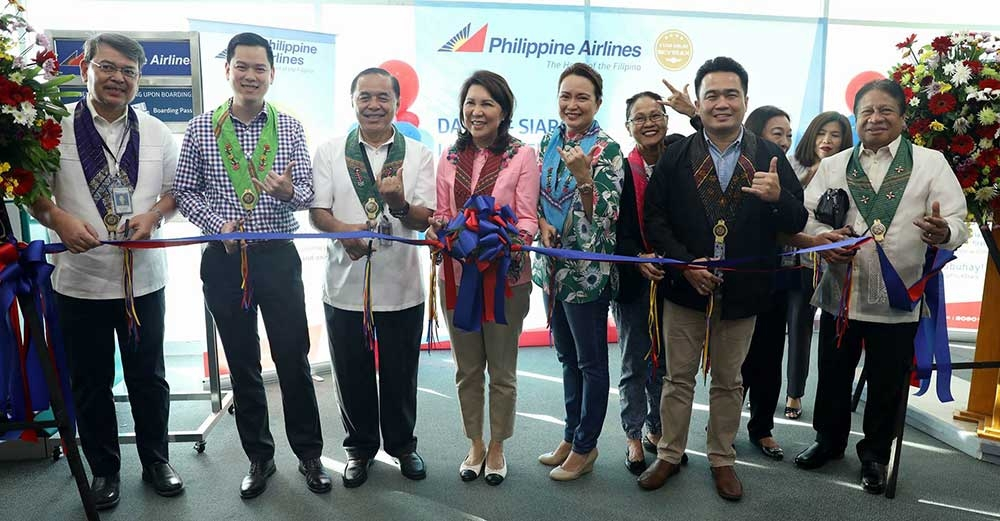 DAVAO. As part of the send-off ceremonies for the maiden journey of the PAL Davao-Siargao flight, a ribbon cutting ceremony was held led by Department of Tourism Secretary Wanda Teo (middle holding bouquet). Also in photo are (from left) PAL Area head Mindanao Sales and Services Victor D. Suarez; PALexpress AVP for Commercial and Business Development Rabbi Ang; SAVP Visayas and Mindanao Sales Harry Inoferio; 1st District Councilor - Davao Mabel Sunga Acosta (representing Mayor Sarah Duterte); Engr. Civil Aviation Manager CAAP Agnes Udang; Davao Vice Mayor Bernard Al-ag; and President and CEO Planters Products lawyer Domingo Duerme. (PAL Corpcom)
