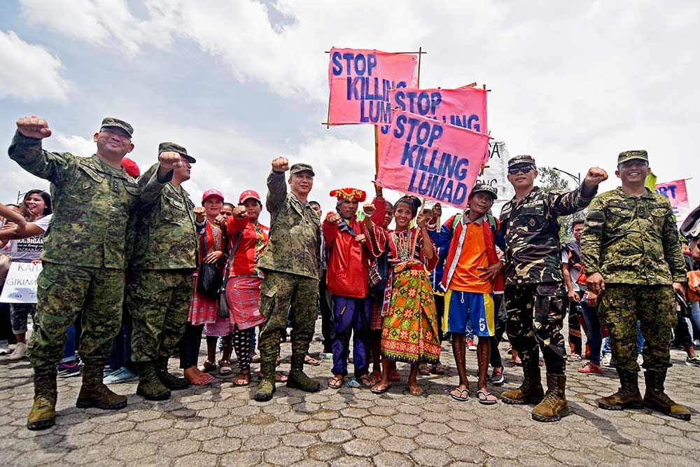 DAVAO. Soldiers join Lumads in calling for a stop to killing of indigenous peoples during yesterday's Martsa Para Sa Kalinaw peace rally at the Rotary Park, Tagum City. (Mark Perandos)