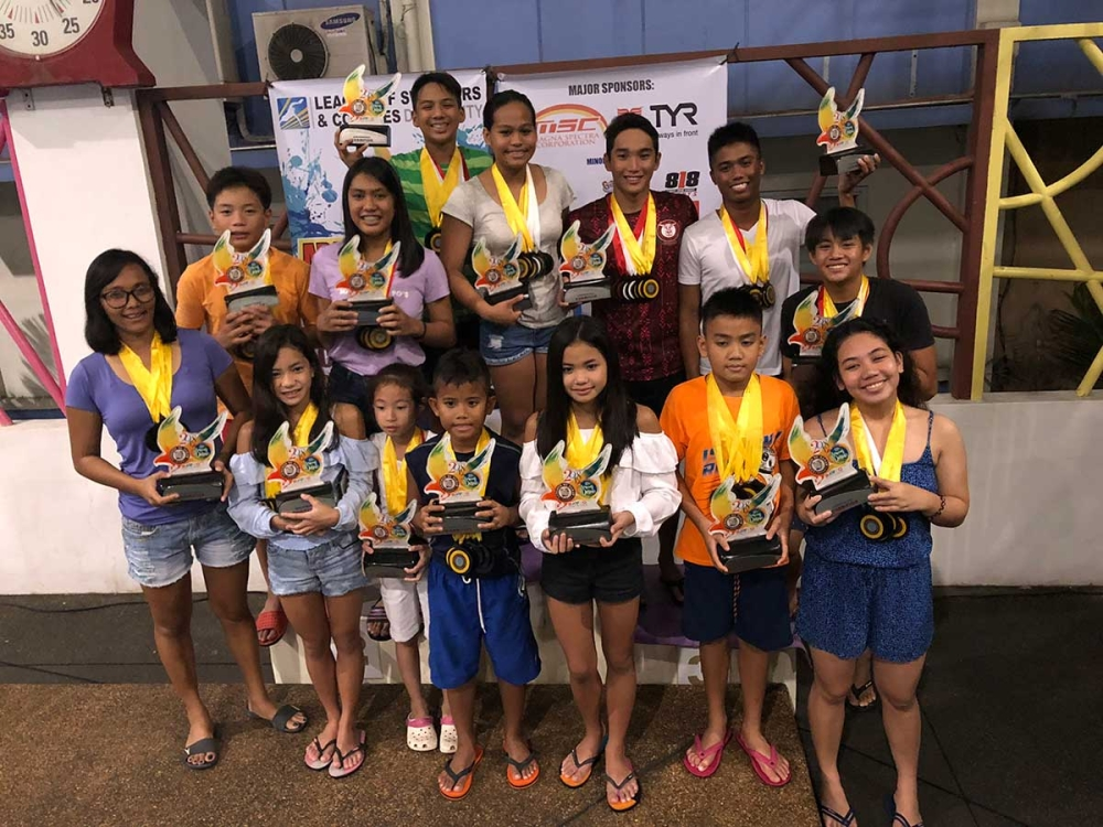 DAVAO. The most outstanding swimmers who ruled the 81st Araw Ng Dabaw 2018 Interschool Swimming Competition poses with their medals and trophies. (Contributed Photo)