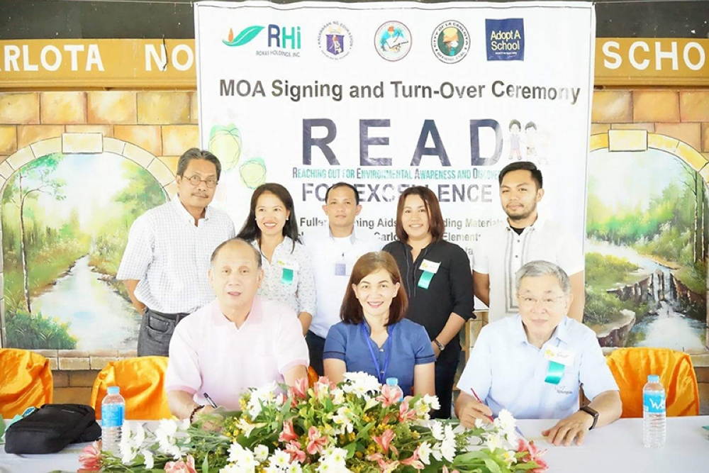 BACOLOD. Officials of Caci and DepEd, along with other partner-representatives, during the agreement signing for the distribution of training materials for teachers and books for children in La Carlota City recently. (Contributed Photo)