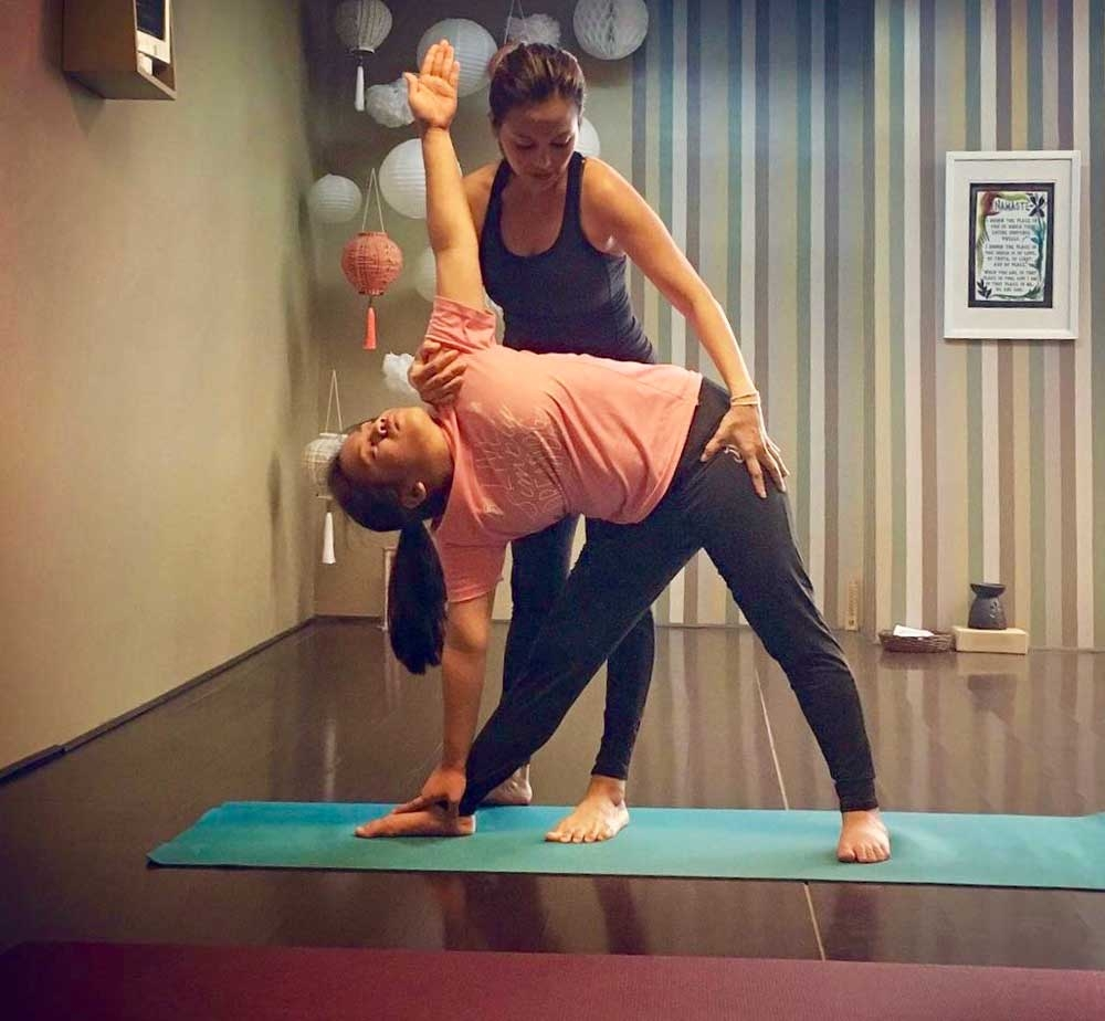 Finding balance. For Mary Deen, yoga also helps parents bond with their children. (Contributed Foto)