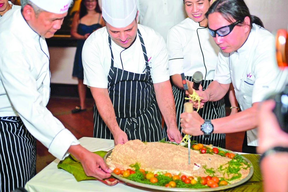 DAVAO. The Chefs do the ceremonial Breaking of the Salt-Crusted Maya-Maya to officially launch the Filipino Food Fiesta buffet.