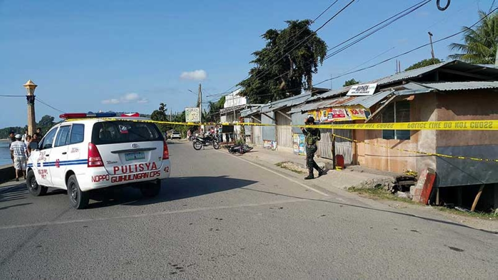 BACOLOD. POLICE cordon the area where Guihulngan City Councilor Paulo Edison Dela Rita was killed by two unidentified men in Barangay Poblacion Monday, April 2. (Contributed Photo/Guihulngan City Police Station)