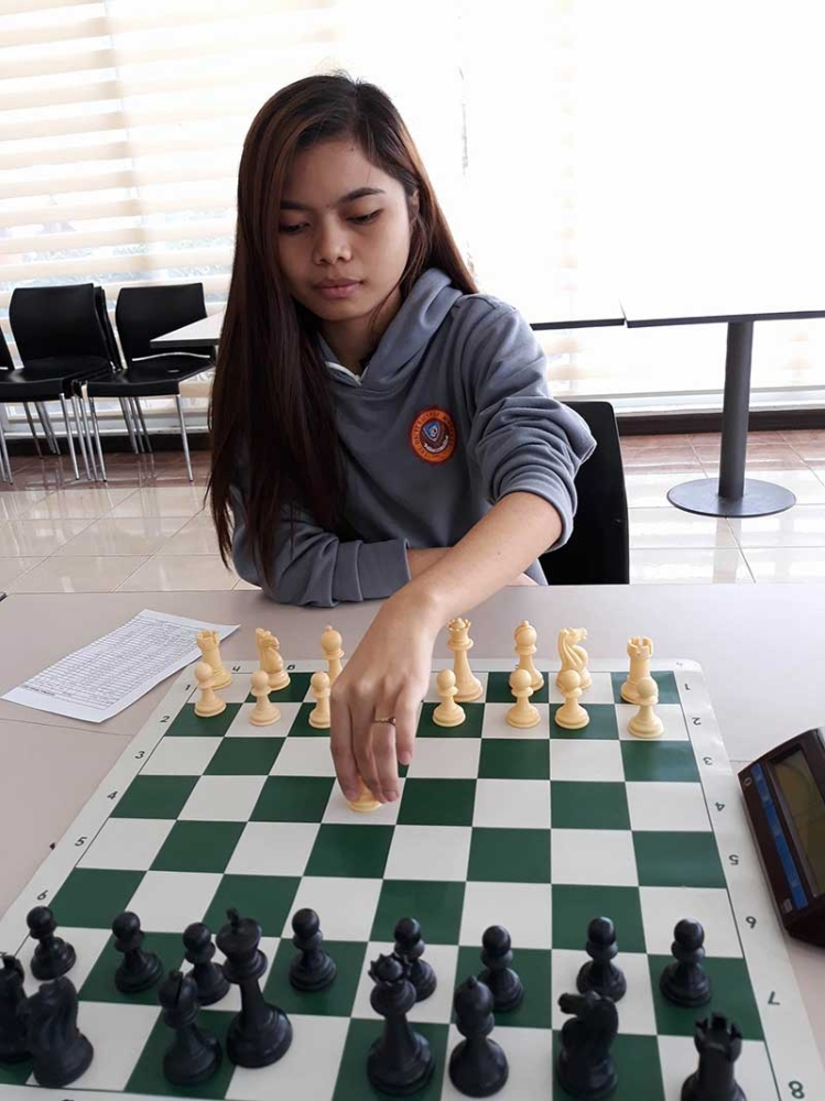 DAVAO. Dhona Yngayo of Davao City make their respective moves during the Prisaa Davao Regional Meet chess competition at the Davao del Norte Sports and Tourism Complex clubhouse Tuesday. (Marianne L. Saberon-Abalayan)
