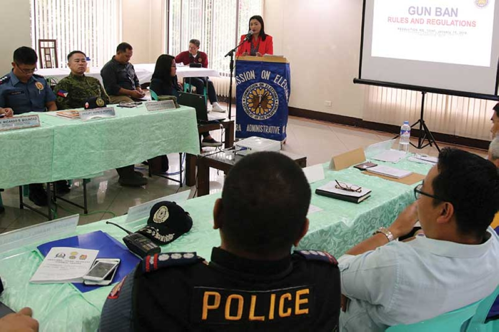 BAGUIO. Commission on Elections Cordillera assistant regional election director Vanessa Mico-Roncal lectures on gun ban rules and regulations during the regional joint security control center command conference in preparation for the barangay and SK elections. (Milo Brioso)