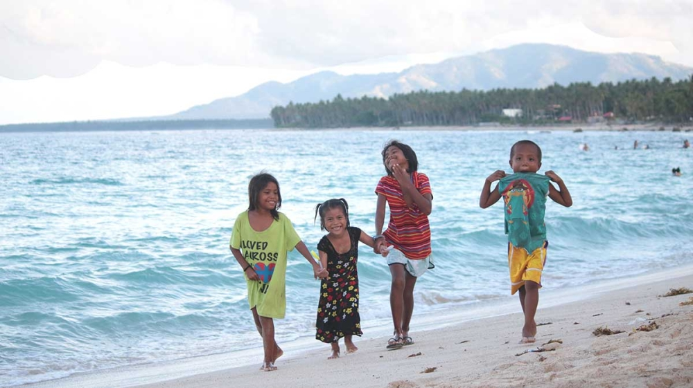 MATI. Four children are enjoying each other's company while strolling around the white sand beach of Dahican. (Ace June Rell S. Perez)