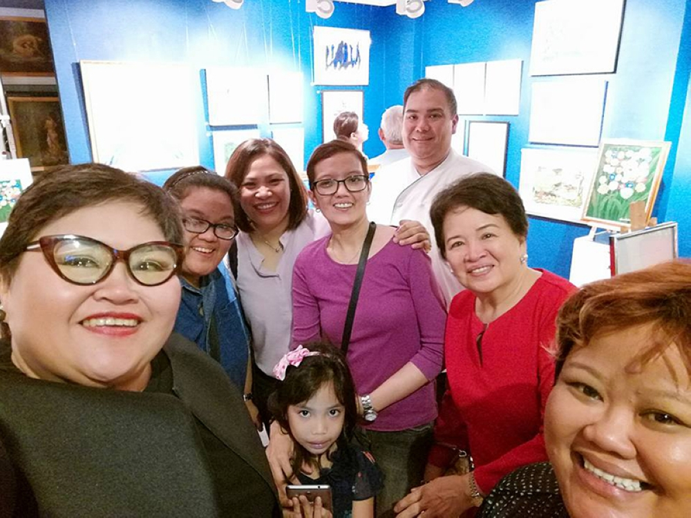 ART IN HER HEART. The artist, Dr. Nina S. Custodio (third from right) with her family during her first solo exhibit opening at Art Portal last Friday, and at the Museum of Modern Art where her