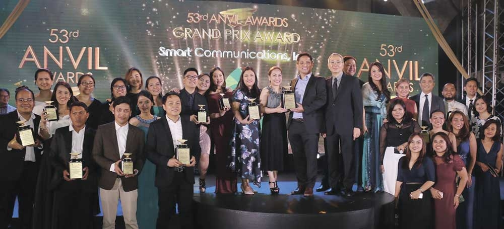 Awards. Smart representatives–led by Chief Financial Officer Chaye Cabal-Revilla (center), SVP for consumer business market development Oscar Reyes Jr., and public affairs FVP Mon Isberto–received the Anvil awards last March 23 at Shangri-La Fort. (Contributed Foto)