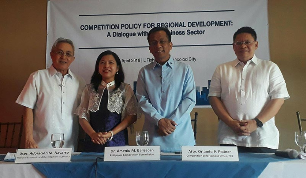 BACOLOD. PCC Chairman Arsenio Balisacan (2nd from right) with (from left) Metro Bacolod Chamber of Commerce and Industry Chief Executive Officer Frank Carbon, Neda Undersecretary Adoracion Navarro, and Competition Enforcement Office Director Orlando Polinar during the Competition Policy for Regional Development dialogue at L'Fisher Chalet in Bacolod City yesterday. (Erwin P. Nicavera)