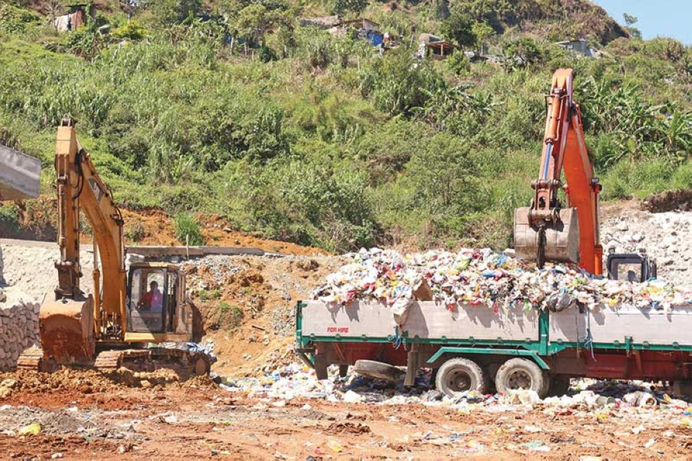 BAGUIO. Workers from the City Government and Camilo Trucking Services continue to construct improvement of the garbage transfer facility at the dairy farm following complaints from the residents of Tuba due to the foul odor emanating from the area. (Milo Brioso)