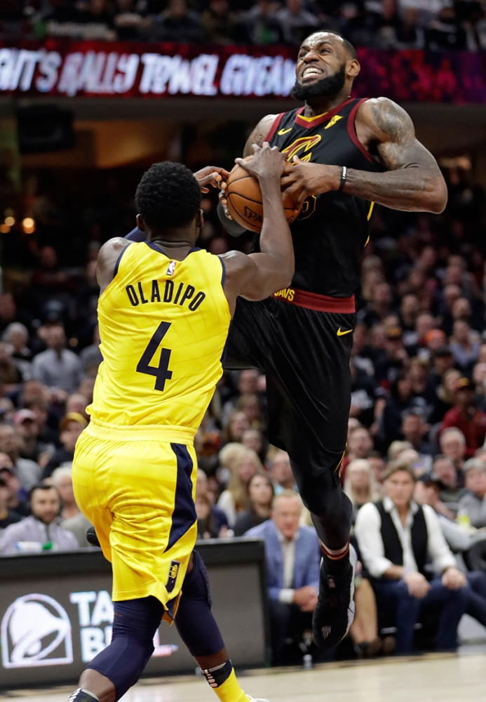 Closed lane. Victor Oladipo stops a drive by LeBron James in Game 1 of their first round series. (AP Foto/Tony Dejak)