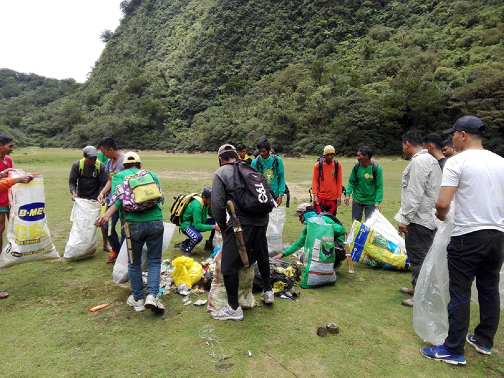 SILAY CITY. Volunteers gather garbage during a clean-up drive in Tinagong Dagat, Silay City. (Penro Photo)