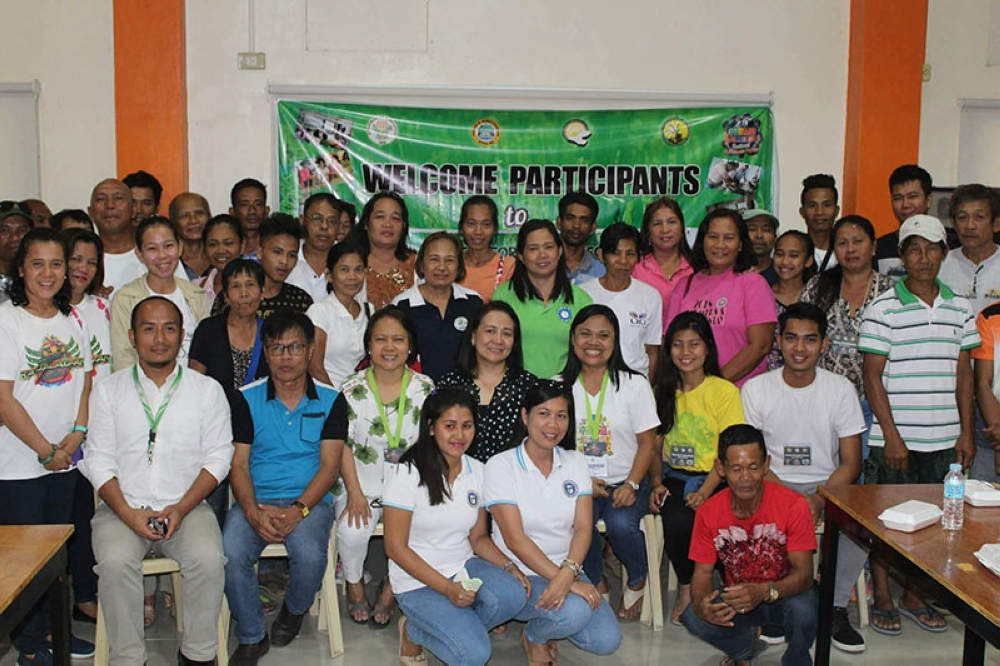 BACOLOD. OPA personnel led by Provincial Supervising Agriculturist Dina Genzola (seated, 3rd from left) with PhilRice Chief Science Research Specialist Dr. Marissa Romero (seated, center) and participants of the two-day Special Rice Investment Forum held at Panaad Park in Bacolod City until April 17, 2018. (Contributed Photo)
