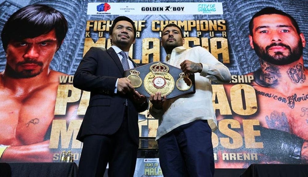 MANILA. Senator and boxing hero Manny Pacquiao, left, and   Argentine WBA welterweight champion Lucas Matthysse   pose for photographers as they hold the WBA   welterweight champion belt during a press conference   in Manila, on Wednesday, April 18, 2018. (AP)