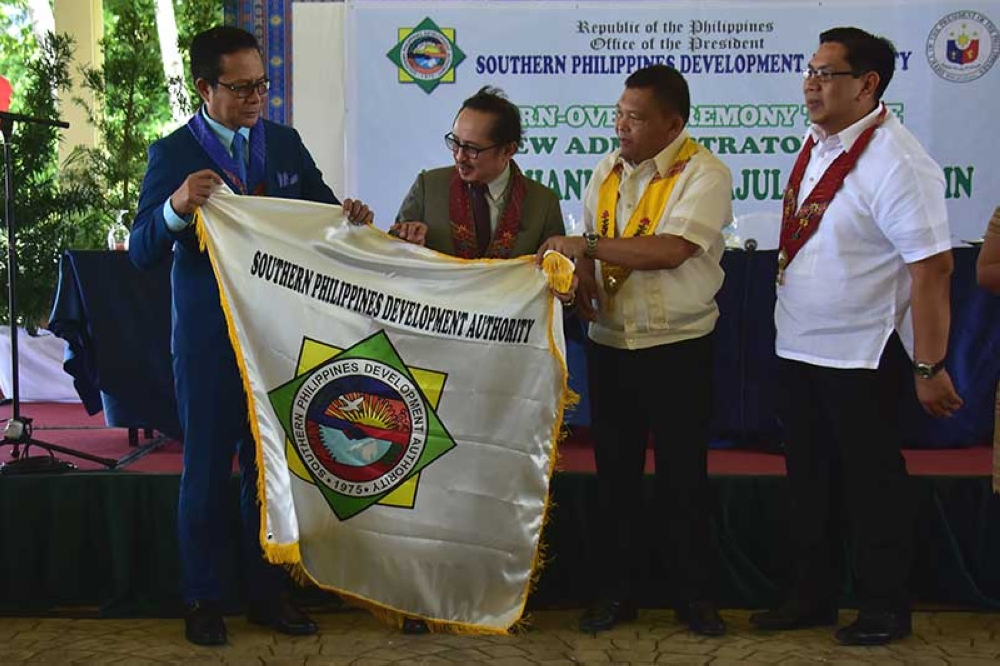 DAVAO. Abdulghani Aljul Salapuddin (leftmost) formally takes over as the administrator and CEO of the Southern Philippines Development Authority (SPDA) Thursday at the Waterfront Insular Hotel, Davao City. In photo with him are (from right) General Santos City Mayor Ronnel Rivera; Public Safety and Security Command Center officer-in-charge Lyndon Paniza; and Mindanao Development Authority chairperson Secretary Datu Abul Khayr Dangcal Alonto. (Macky Lim)