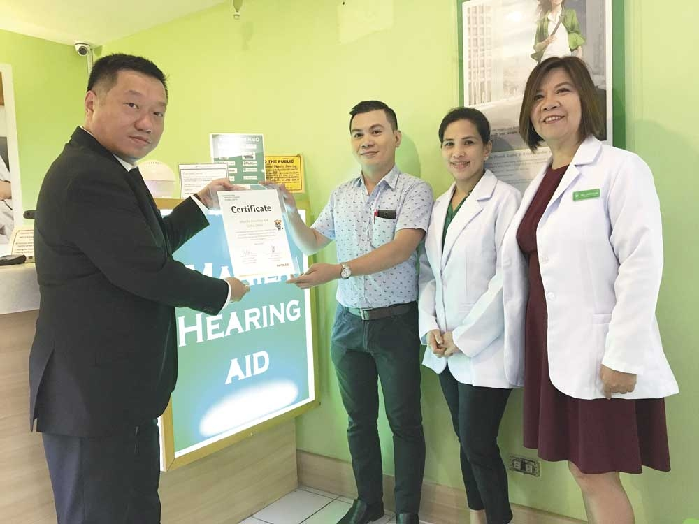Manila Hearing Aid representatives  receive the certification from Kelvin Seah of Phonak (left). (Contributed Foto/Christian B. Quilo)