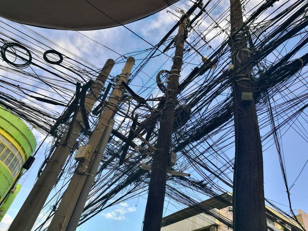 Dangling mess. Tangled telecommunication cables, like these ones on posts at corner Junquera and P. del Rosario Sts. in Cebu City, are eyesores that have to be fixed, City Hall says. (SunStar Foto/Arni Aclao)