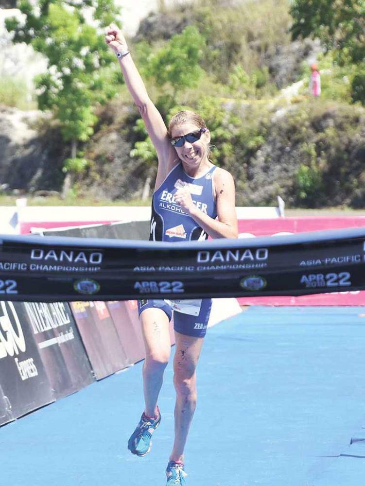 CELEBRATION. Carina Wasle celebrates as she crosses the finish line a minute ahead of the field of the women's division in Xterra Danao Asia Pacific champion-ships. (SunStar photo/Ruel Rosello)