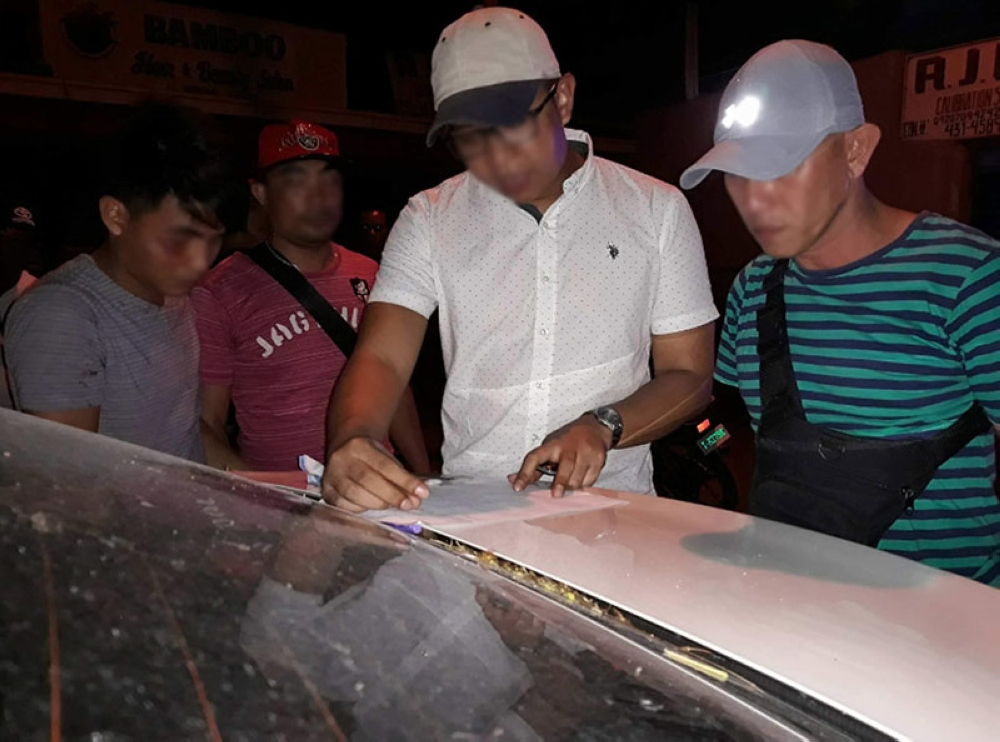 BACOLOD. Police conduct inventory on the P225,000 worth of illegal drugs recovered from 23-year-old Bryan Blasi in a buy-bust at Barangay 28, Bacolod City Friday. (Contributed Photo)