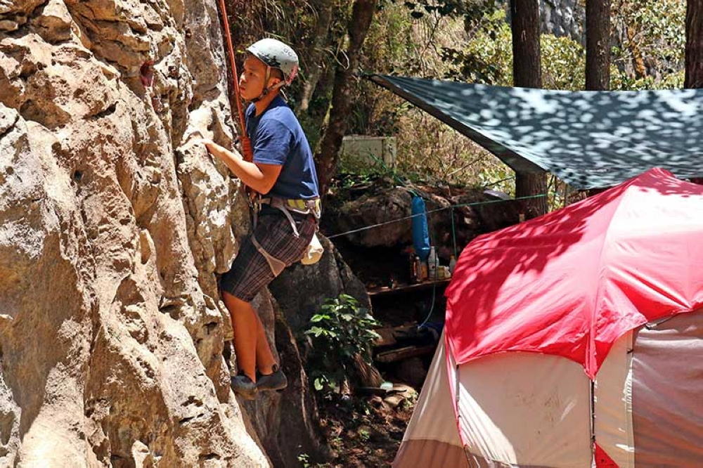 CORDILLERA. A local tourist buckle down to try the natural rock wall climbing at the eco-valley park in Sagada, Mt. Province. (Milo Brioso)