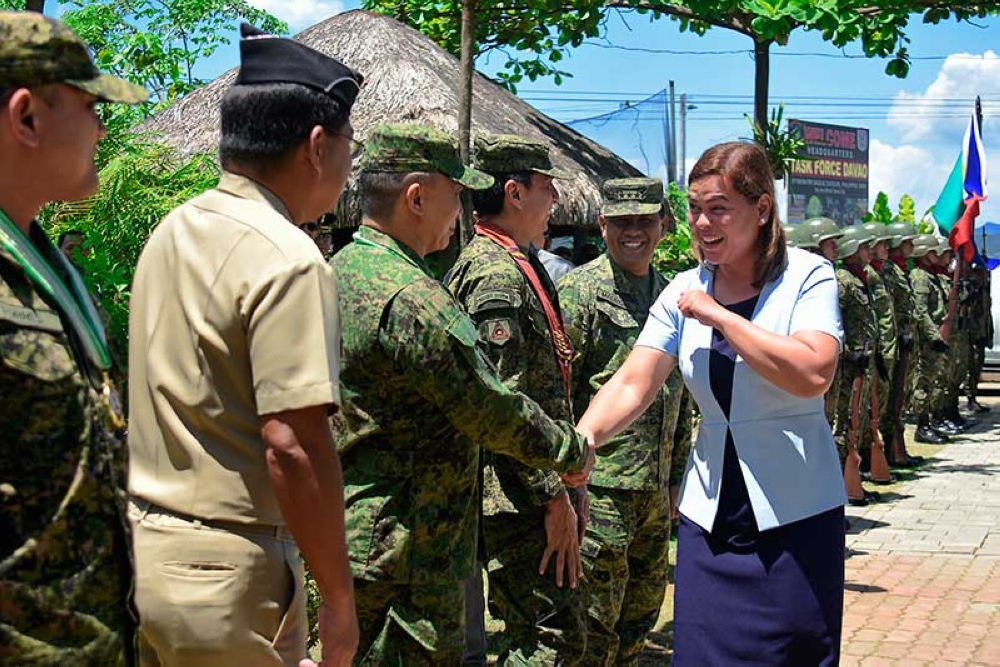 DAVAO. Mayor Sara Z. Duterte-Carpio greets top military officials of the region during the 10th anniversary of Task Force Davao in Sta. Ana Pier, Davao City, on April 24, 2018. (Mark Perandos)