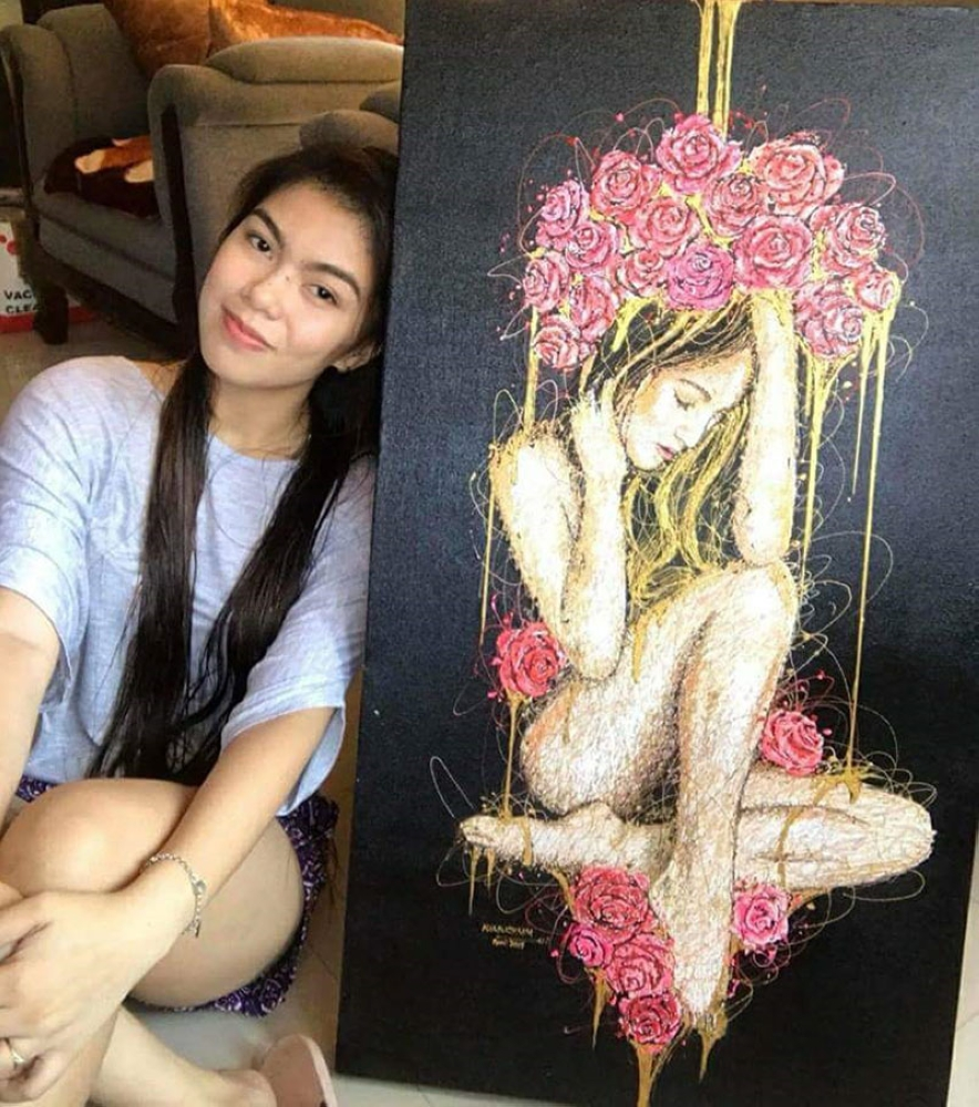 """BACOLOD. Syringe artist from Valladolid Kimberly Joy Mallo Magbanua and her masterpiece """"Bare Vermilion."""" (Contributed Photo)"""