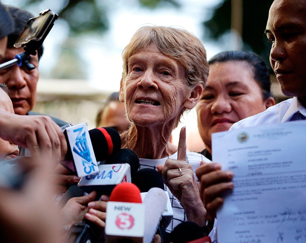 MANILA. In this April 17, 2018, file photo, Australian missionary Sister Patricia Fox gestures as she is interviewed by reporters after she was released from custody at the Bureau of Immigration in Manila. (AP Photo)