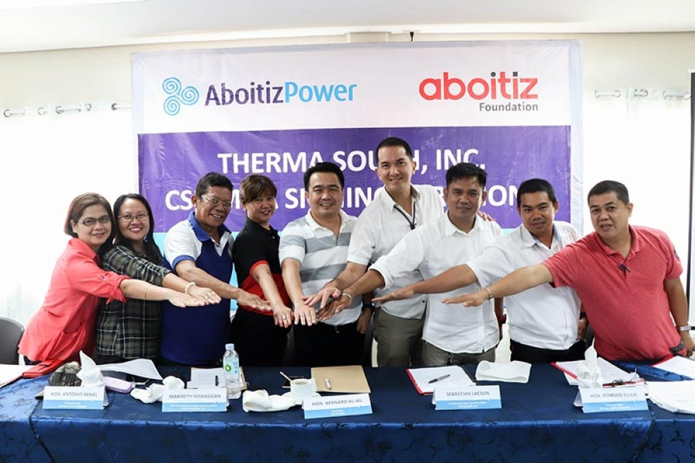 DAVAO. Project partners and beneficiaries from various sectors ink their respective Memorandum of Agreement with AboitizPower subsidiary Therma South, Inc. (TSI) and Aboitiz Foundation, Inc. for the implementation of 10 corporate social responsibility (CSR) projects for the year 2018.  Present during the signing activity were (L-R): Inawayan Elementary School principal Raziel Francisco; Inawayan National High School principal; Binugao barangay chairman Antonio Saniel; Aboitiz Foundation first vice president and COO Maribeth Marasigan; Davao City Vice Mayor Bernard Al-ag; TSI president and COO Sebastian Lacson; Inawayan barangay chairman Romulo Elula; United Kaibigan Multipurpose Cooperative president Charlo Deniega; DepEd Davao del Sur Education Program supervisor Christopher Felipe. (Contributed Photo)