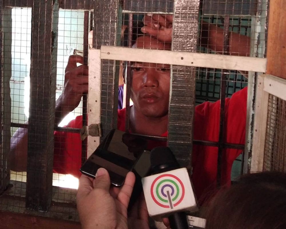 BACOLOD. Primary suspect Aguilar (left) was arrested Wednesday after he allegedly killed a man and his daughter in their house at Silay City Monday night. His arrest came after the confession of the victim's mother, Rogelia Landao. (Glazyl Y. Masculino)