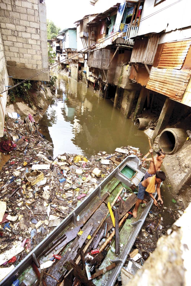 Risk at the margins. Young boys scavenge for items they can use from the garbage floating in Mahiga Creek bordering Mandaue and Cebu cities. Out-of-school youth and the marginalized have a higher risk of initiating drug use, according to the United Nations Office on Drugs and Crime. (SunStar File)