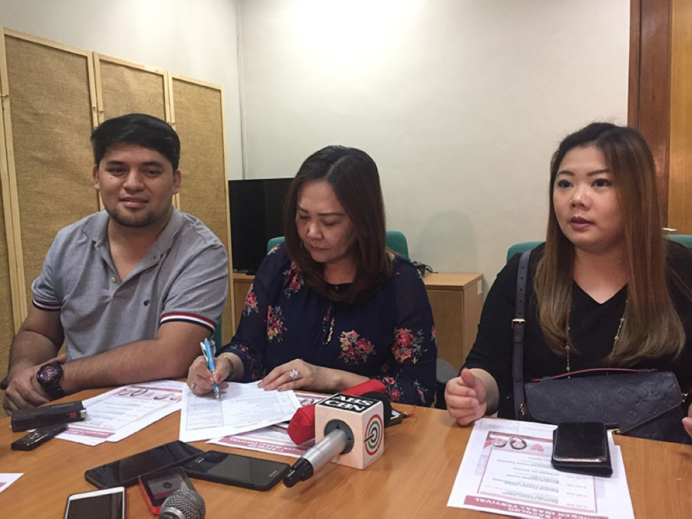 BACOLOD. Councilors Cindy Rojas, and Em Ang with Israel Salanga. (Merlinda A. Pedrosa)
