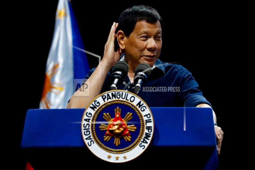 Philippine President Rodrigo Duterte addresses the Filipino community in Singapore on Saturday, April 28, 2018, in Singapore. (AP Photo/Yong Teck Lim)