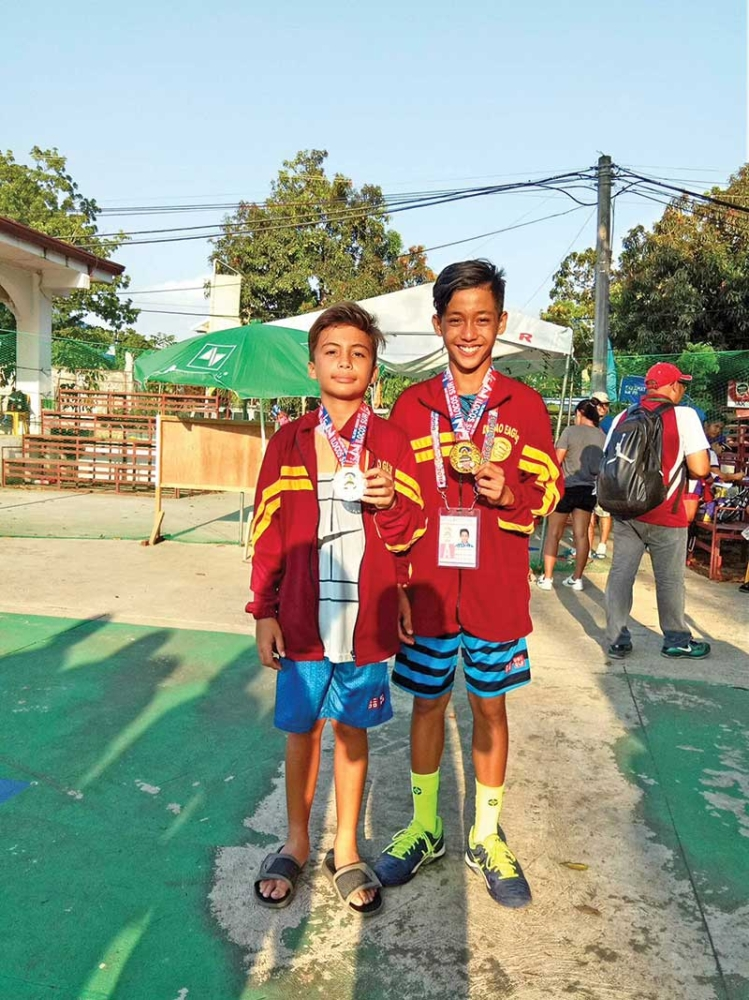 ILOCOS. The tandem of Rey Anthony Byrd and Jude Michael Padao wins the Palarong Pambansa 2018 elementary boys tennis doubles gold medal. (Contributed photo)